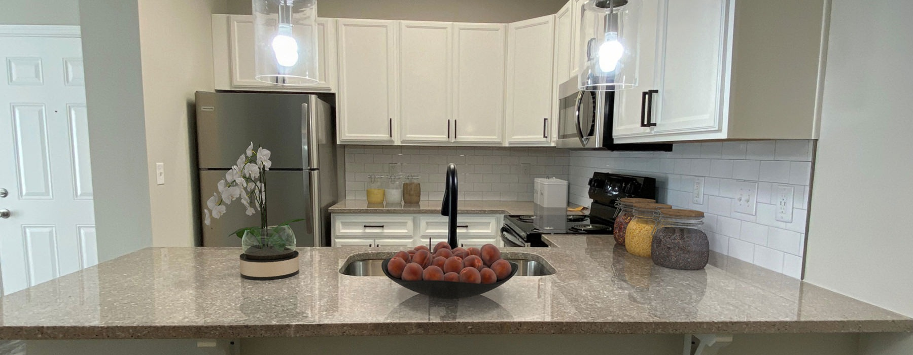 Modern Well Lit Apartment Kitchen At The Pointe At Heritage Apartments